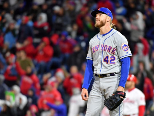 New York Mets starting pitcher Noah Syndergaard reacts after allowing a two run home run during the fourth inning to Philadelphia Phillies third baseman Maikel Franco (not pictured) at Citizens Bank Park.