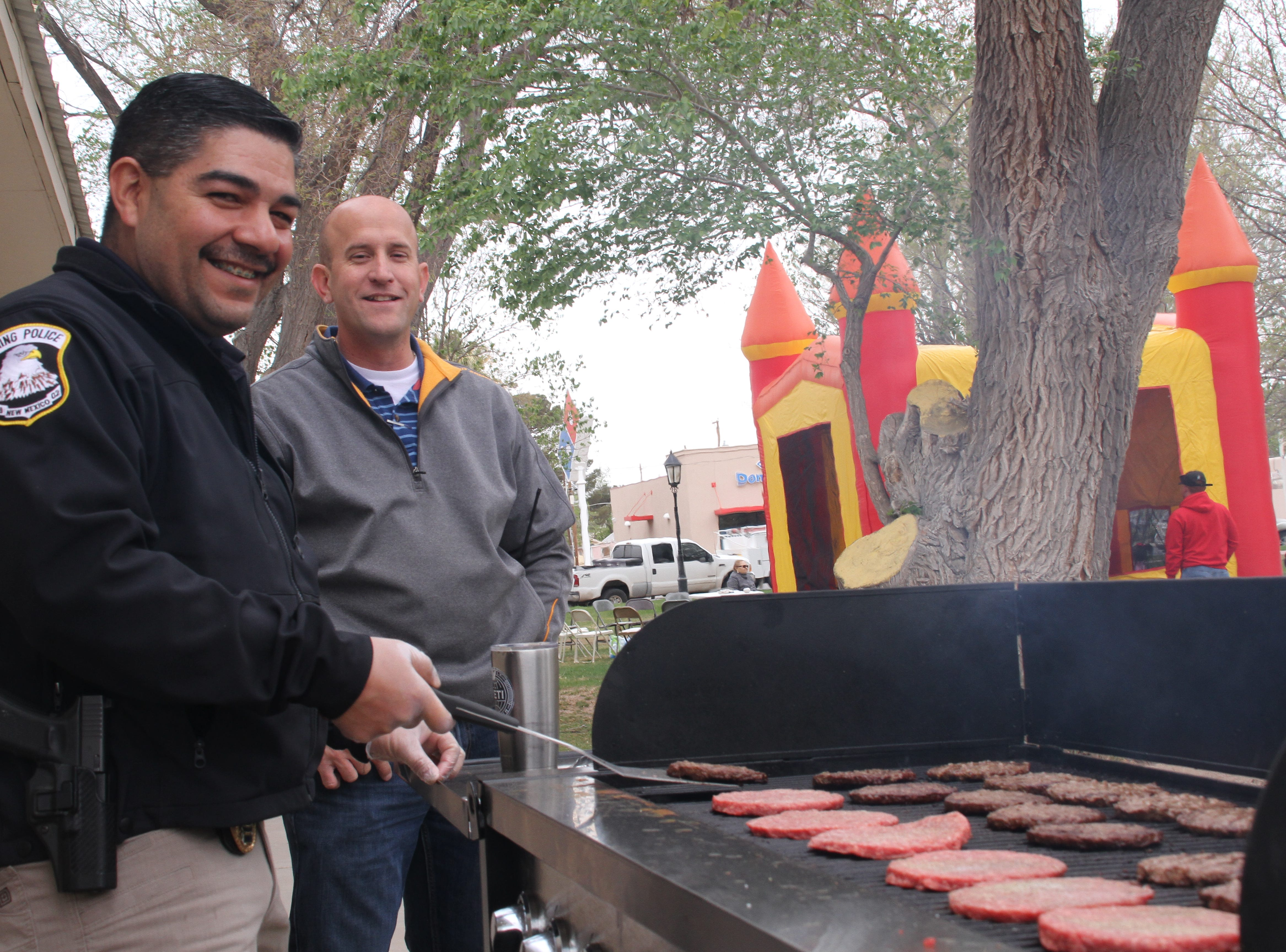 From left, Deming Assistant Police Chief Alex Valdespino and Chief Bobby Orozco  prepping and flipping burgers for approximately 630 attendees.