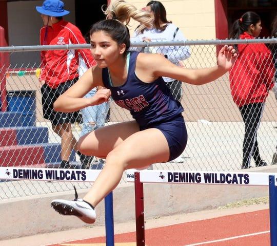 Lady 'Cat Krista Jimenez clear the hurdle in the 100m race.
