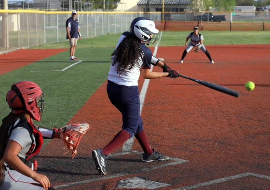 Lady 'Cat Brianna Flores doubled home a run in the bottom of the first inning to spot Deming High a 3-1 advantage. Centennial High would rally late to take a 13-10 victory in District 3-5A softball.