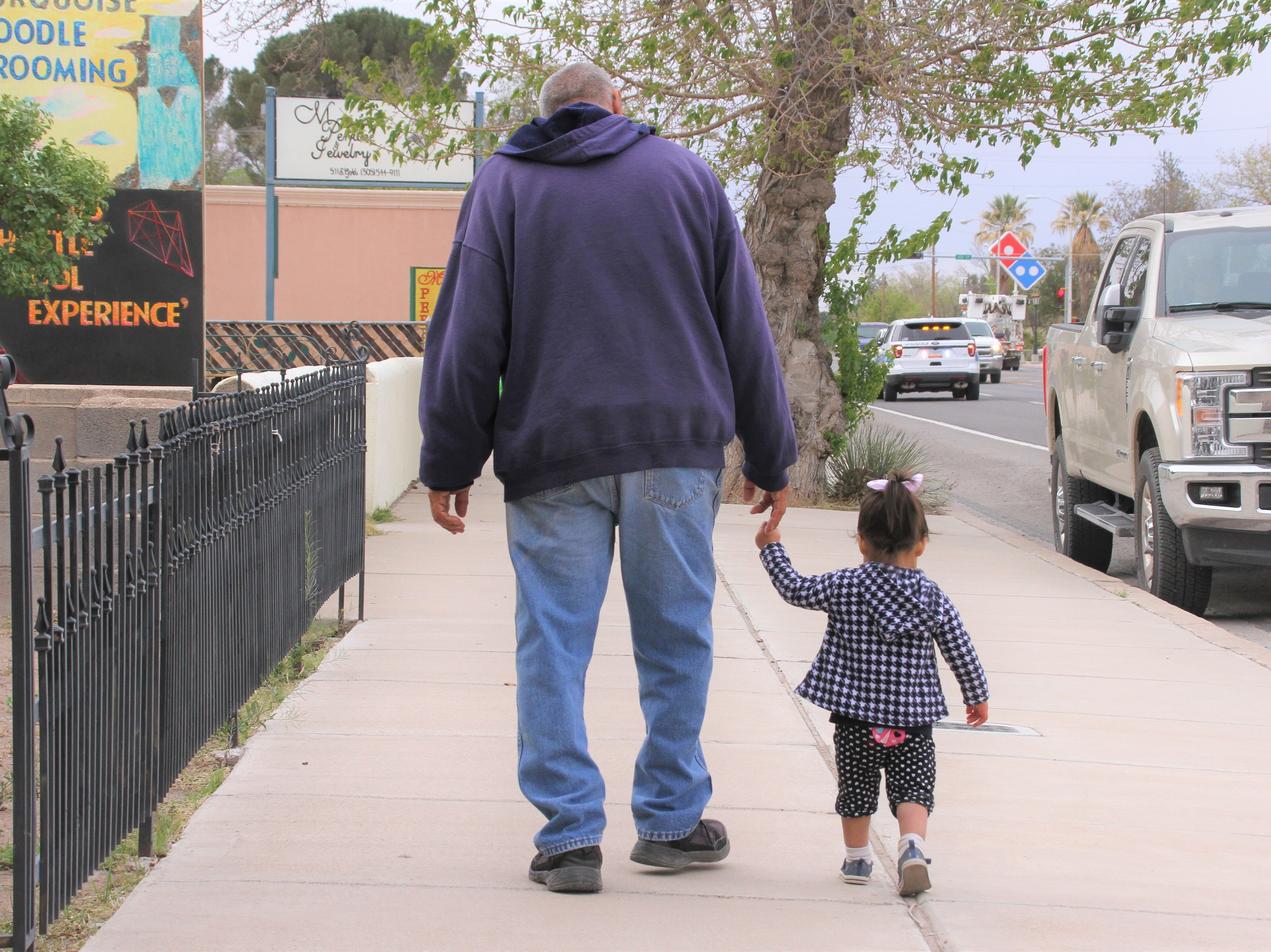 Left, Grandpa Ricky walking along with granddaughter Allie Baca.