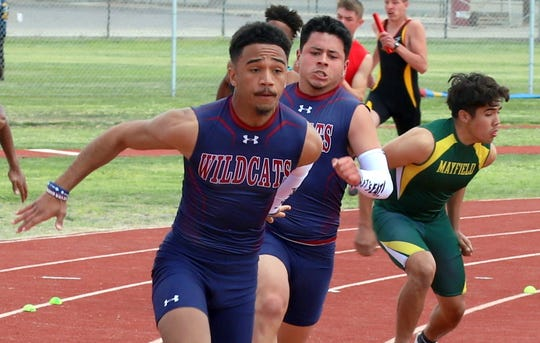Wildcat Ceazar Chavez reaches back for the baton during the 4x100m relay