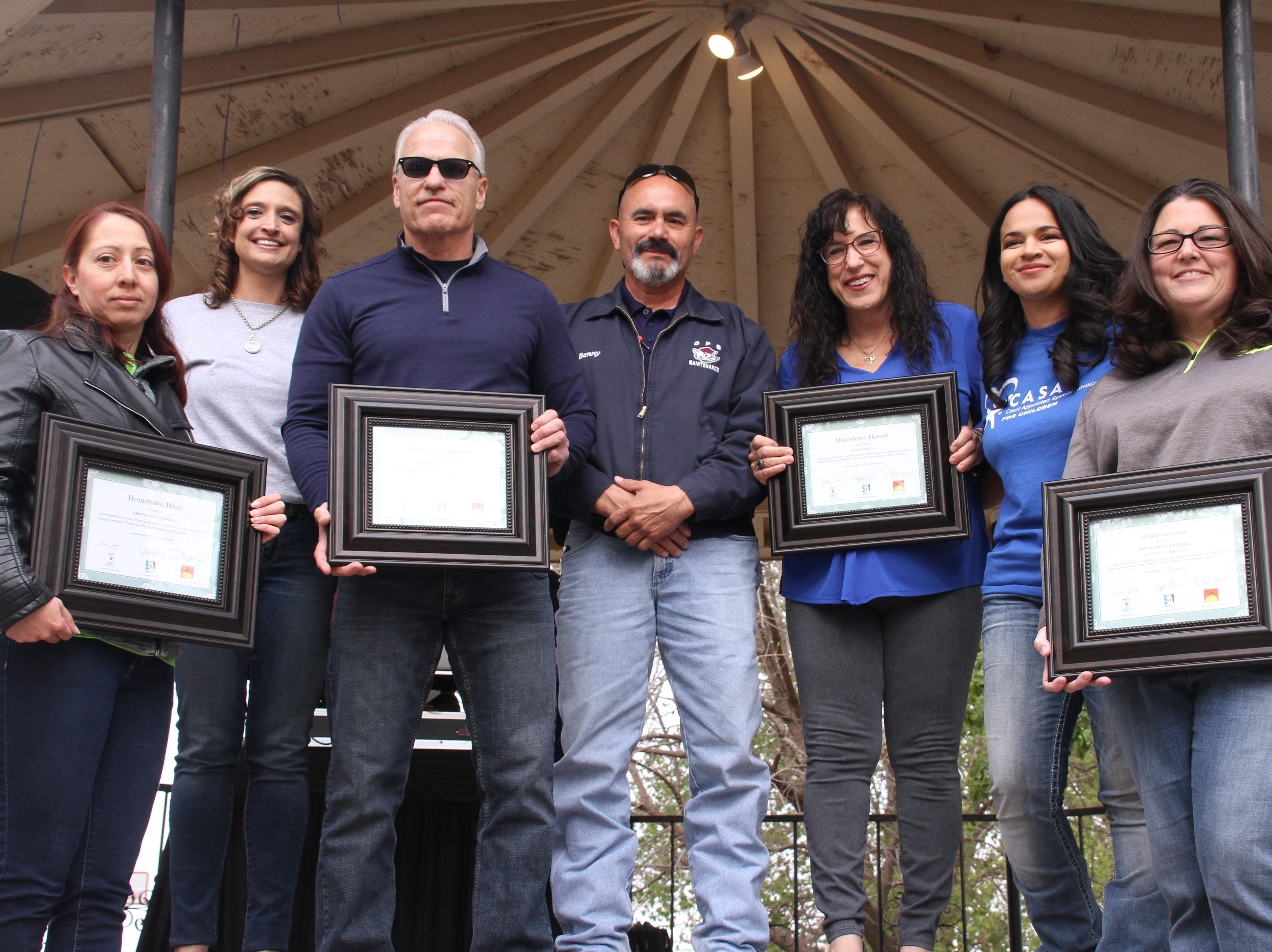 """Those holding framed certificates, were recognized for being Deming's """"hometown heroes"""" and for always giving back to children in the community. Those who were recognized from left, are, Cristina del Palacio, Peppers Super Market, Gina Gentile and Jennifer Delaney."""