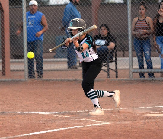 Oñate  outfielder Leslie Sanchez lays down a perfect sacrifice bunt on Monday night as the Knights took on the Las Cruces High Bulldawgs.