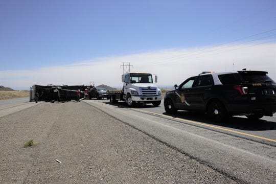 A pickup truck pulling a travel trailer heading eastbound on US Highway 70 overturned about 10:11 a.m. Tuesday, April 16, 2019, police said.