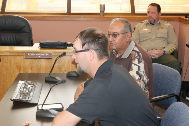 (From left)-Eddy County Fire Services Director Joshua Mack, Village of Loving Mayor Pete Estrada talk about consolidation of the Village of Loving Fire Department with Eddy County during the April 16 Eddy County Board of Commissioners meeting. Eddy County Sheriff Mark Cage.