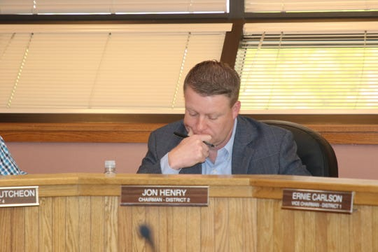Jon Henry, chair of the Eddy County Board of Commissioners, mulls a proposal during the April 16 meeting.