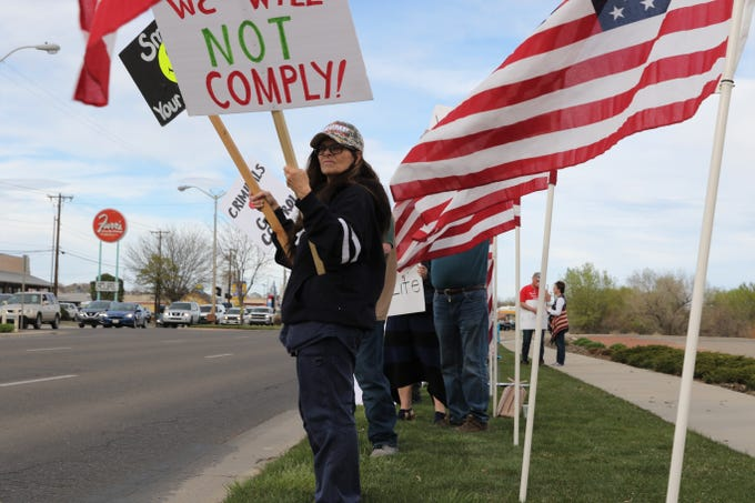 Dana Bearden participates in the Tax Day Rally, Monday, April 15, 2019, at Farmington Museum at Gateway Park.