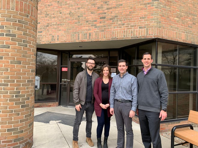 Ivywood Classical Academy board members (from left) Jim Musgrave, Myranda Fabian, Tyler Horning and Troy Morris stand  in front of the school's  building.