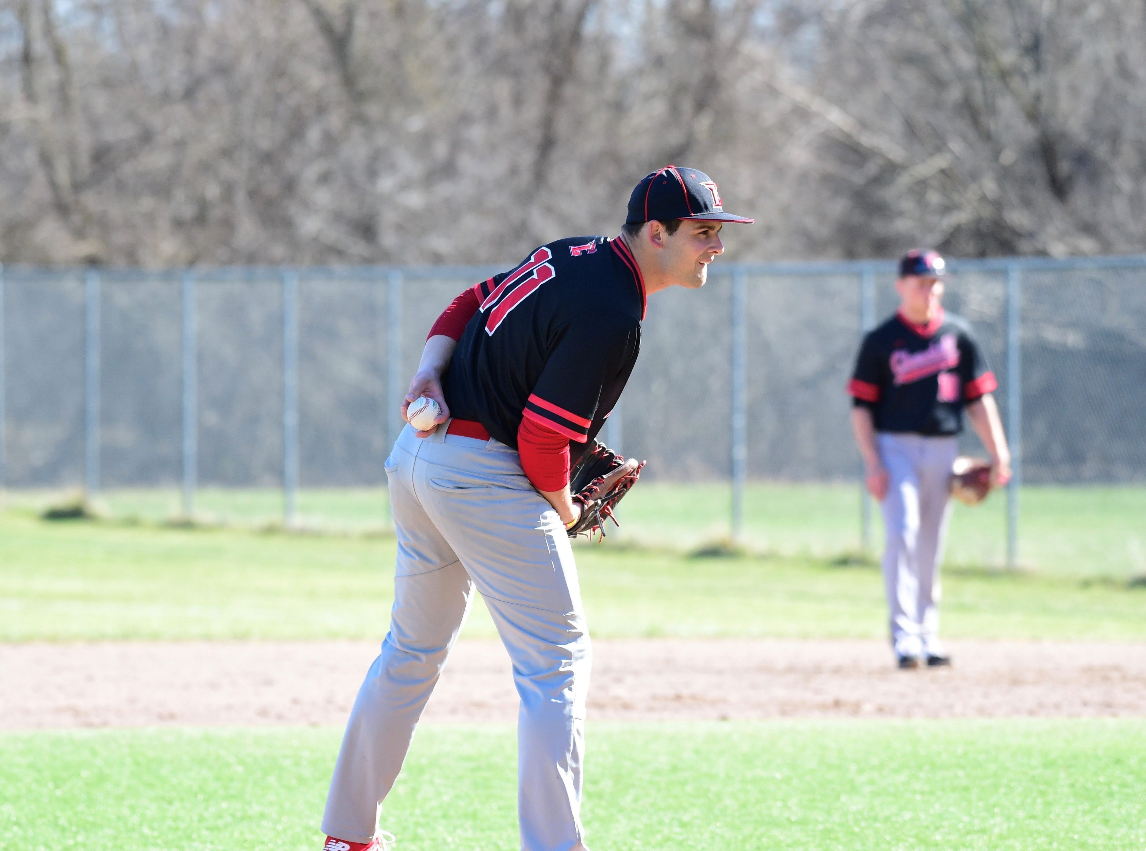 Livonia Churchill pitcher Drew Alsobrooks get the sign in a game against Stevenson on April 15, 2019.