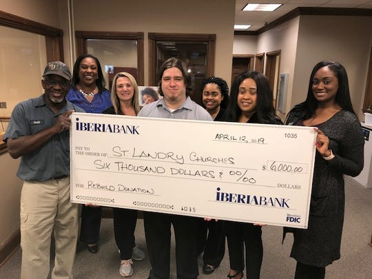 The Rev. Gerald Toussaint, Mt. Pleasant Baptist Church; Yvette Bernard, IBERIABANK Opelousas Branch Manager; and the IBERIABANK Opelousas Branch Team: Darlene Fontenot, Tyler Franchebois, Destinee Charles, Marlena Jones, and Whitney Livings.