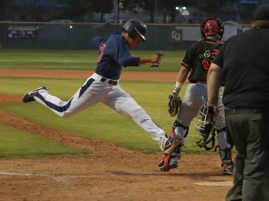 Jason Leon crosses home plate for a run against Palm Desert, April 15, 2019.