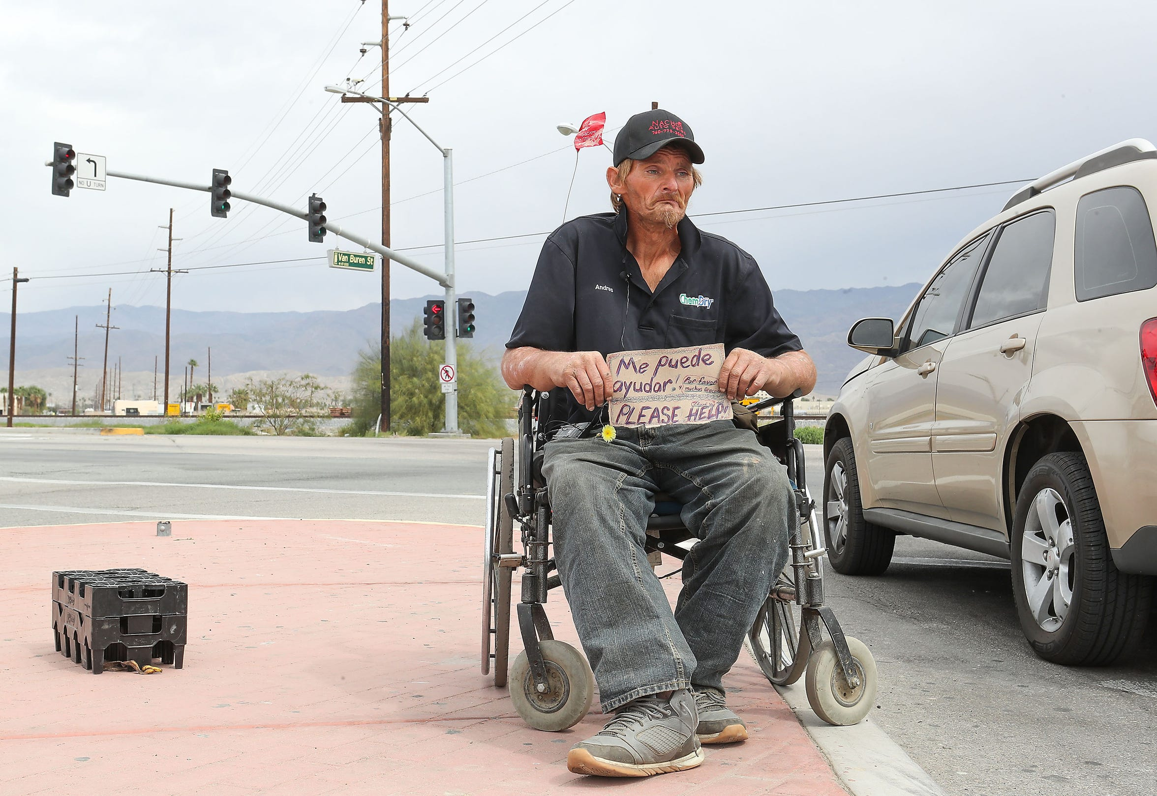 Robert Hensley panhandles for enough money to buy some heroin which treats his pain and his addiction in Indio , April 8, 2019.