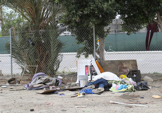 In this 2019 file photo, a person sleeps on the ground in a homeless camp behind the One Stop Shoppe in Indio. California Gov. Gavin Newsom recently proposed increases to mental health care to help fight homelessness in California.