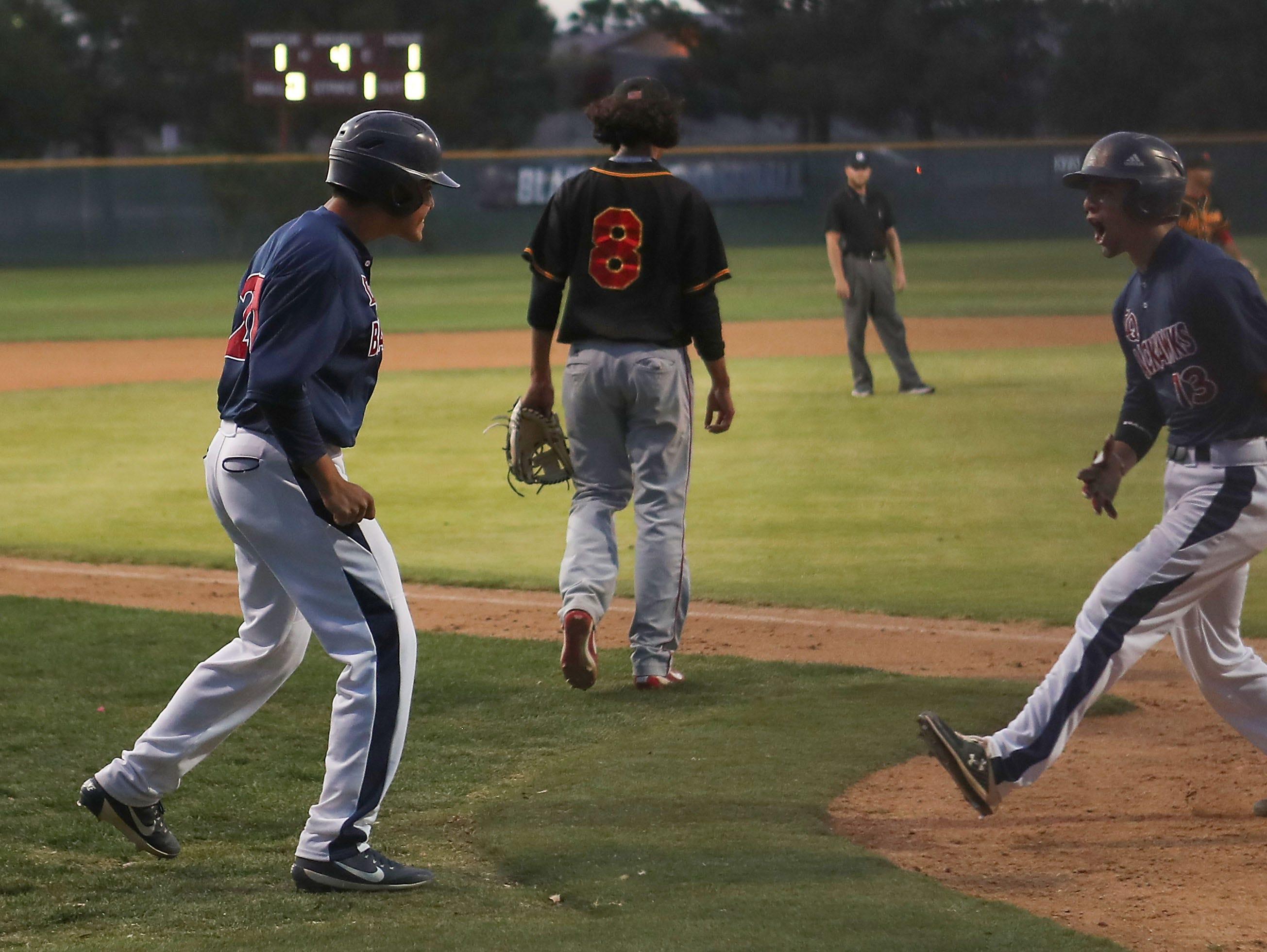 La Quinta players celebrate two runs socred against Palm Desert, April 15, 2019.