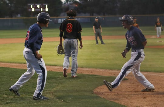 La Quinta players celebrate two runs socred against Palm Desert, April 15, 2019.