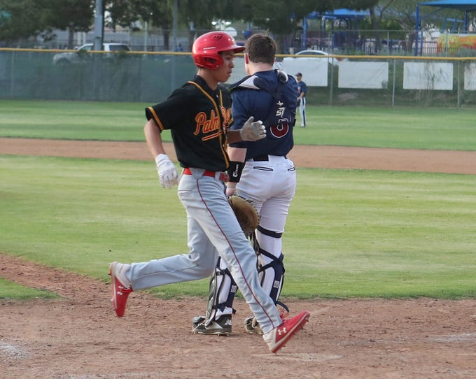Jamieson Gateb of Palm Desert crosses home plate for a run against La Quinta, April 15, 2019.