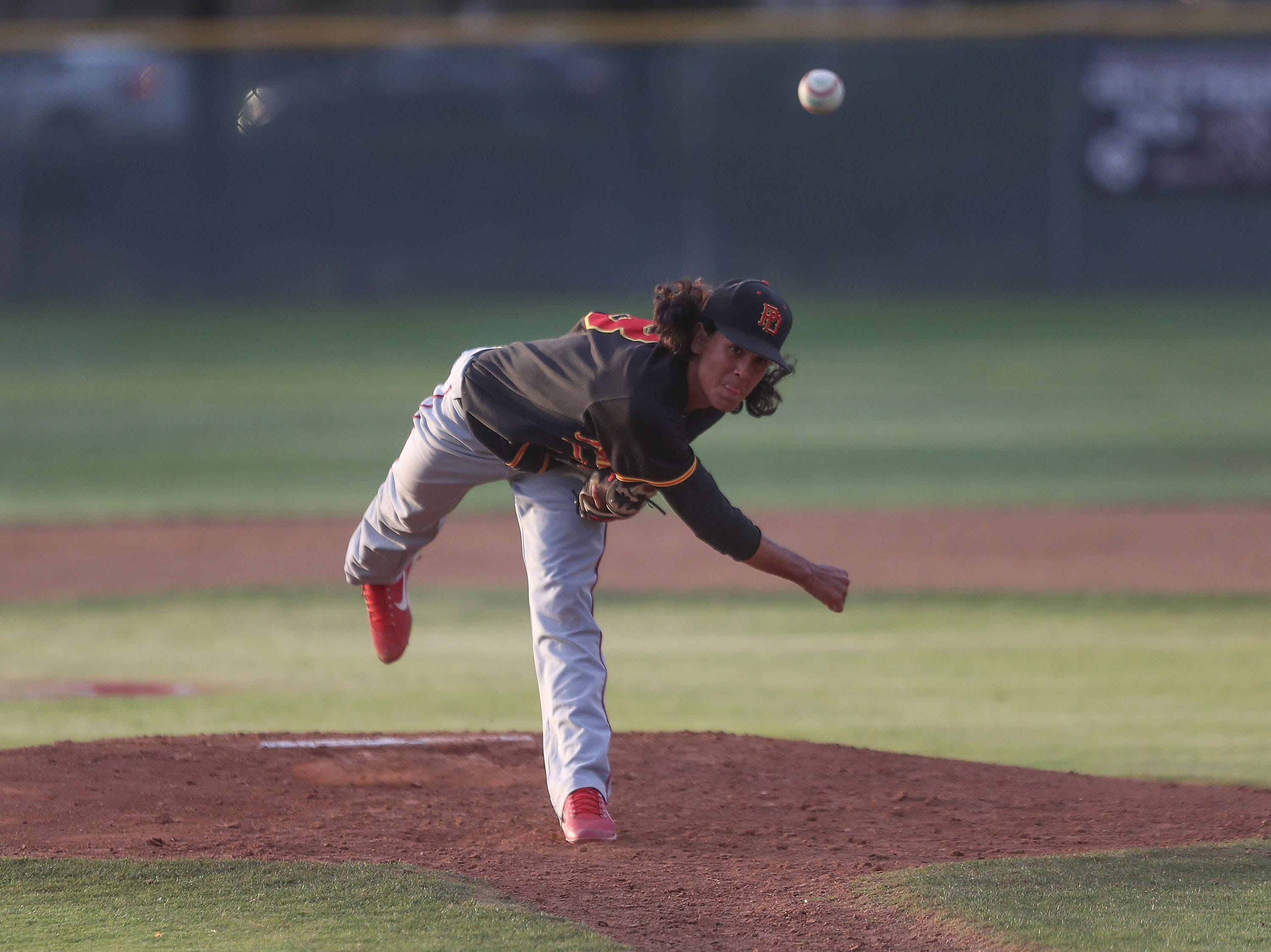 Emiliano Torres of Palm Desert pitches against La Quinta, April 15, 2019.