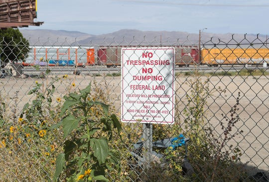 "A large homeless encampment where dozens of people live has ""No Trespassing"" signs on this large patch of empty land in Indio, April 8, 2019."