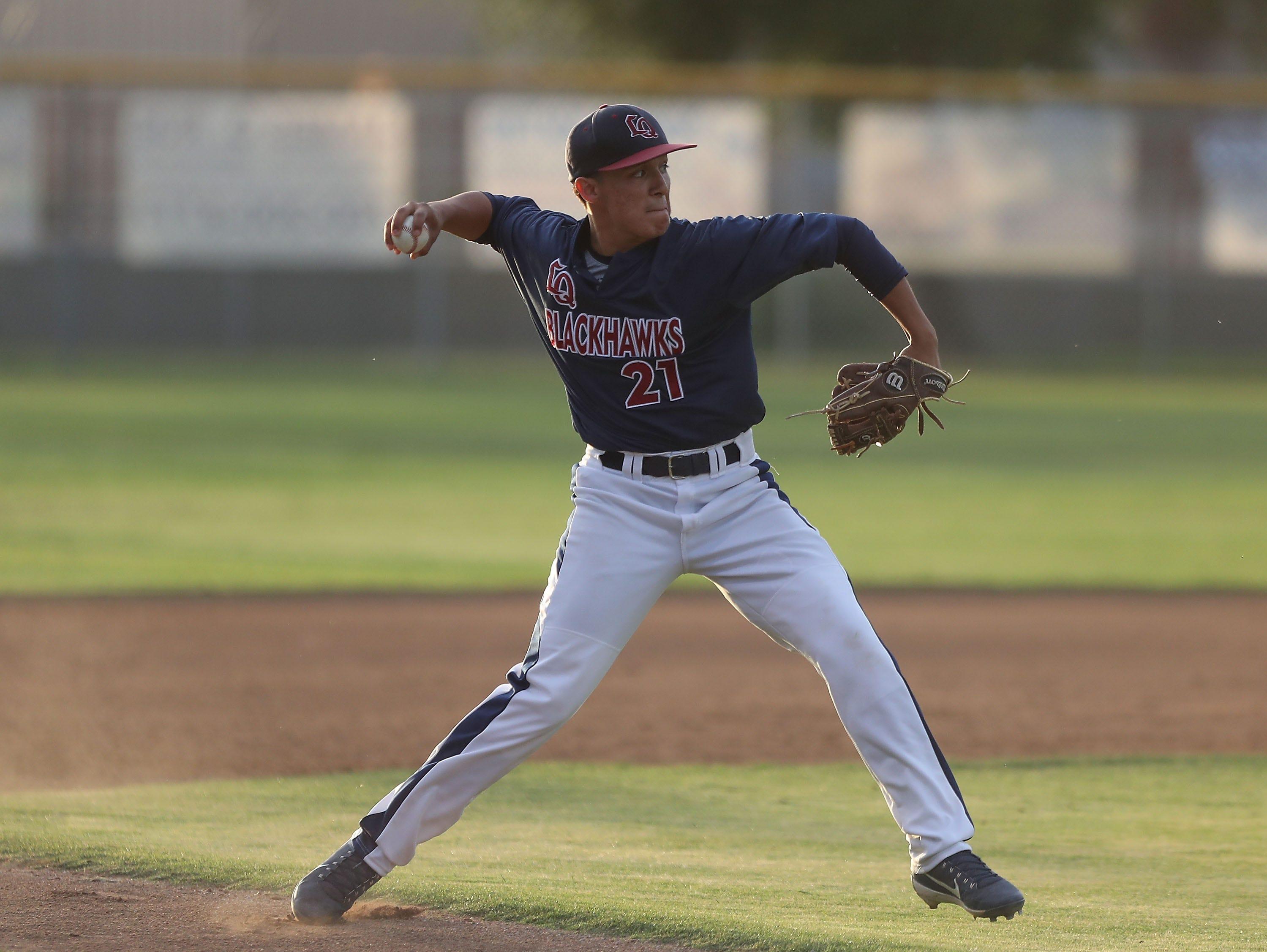 Jason Leon of La Quinta fields a ground ball versus Palm Desert, April 15, 2019.