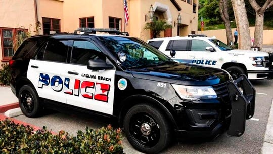 FILE - This undated photo provided by the Laguna Beach Police Department shows their newly decorated Police SUV patrol vehicles in Laguna Beach, Calif.