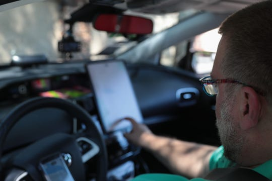 Kenneth Martinson checks his driving apps before starting to work in Palm Springs during the first weekend of the Coachella Valley Music and Arts Festival, April, 13, 2019.