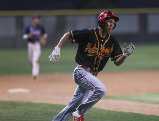 Jameison Gateb of Palm Desert sprints toward home for a run against La Quinta, April 15, 2019.