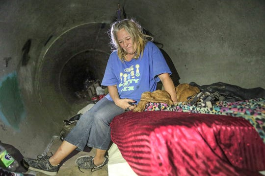 Marcie Meserole, who lives in a stormwater drain in Coachella, says it's hard for her to access health care because of the distance she has to walk on her injured leg, Nov. 30, 2018. Riverside County Supervisor V. Manuel Perez said a governor-appointed council isn't looking closely enough at rural areas of the state.
