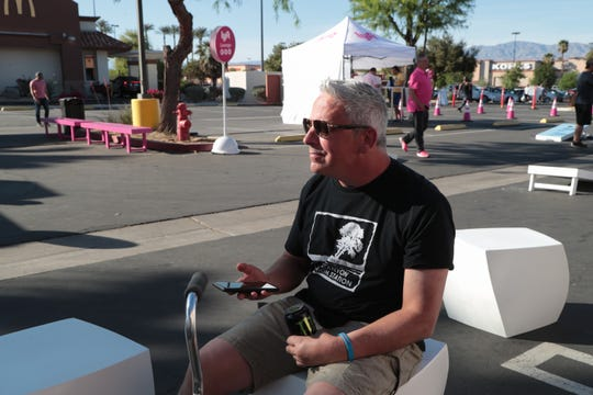 """John Turner takes a break at a rest stop set up by Lyft for drivers during the Coachella Valley Music and Arts Festival, La Quinta, Calif., April, 13, 2019. He opts to drink a Monster during the break which he calls a """"tool of the trade""""."""