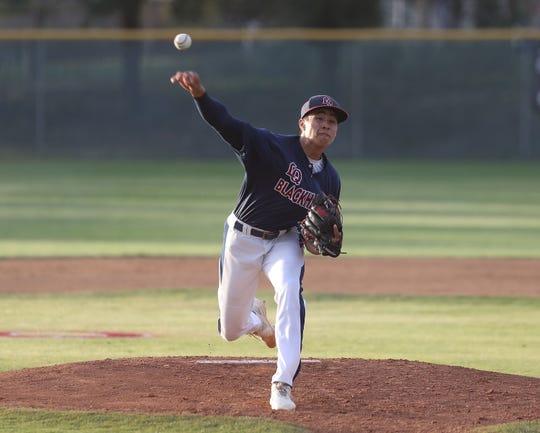 Josiah Torres of La Quinta pitches against Palm Desert, April 15, 2019.