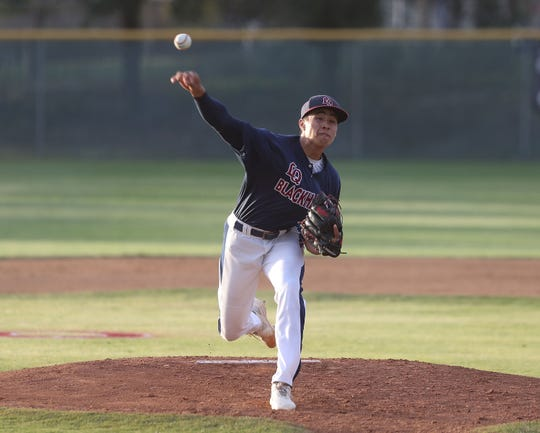 Josiah Torres of La Quinta pitches against Palm Desert, April 15, 2019.