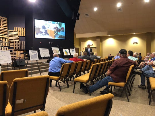 County Administrator Dan Schebler talks Monday to around 50 people gathered at Woodbine Church in Pace for the first of two public workshops aimed at educating residents about the ins and outs of the county's budget and infrastructure processes.