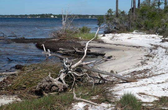 Escambia County will auction off 14 Innerarity Island lots, including two frontingPerdido Bay, later this month.