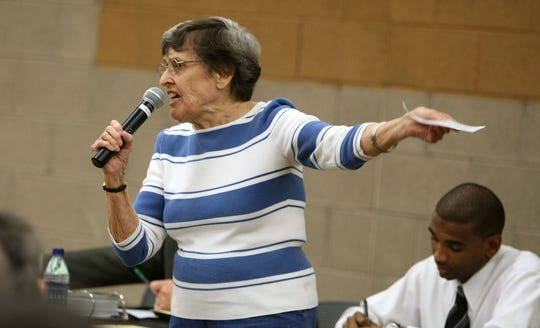 Greta Rogers speaks her mind during a 2009 public hearing on city budget cuts, at Pecos Community Center in Ahwatukee.