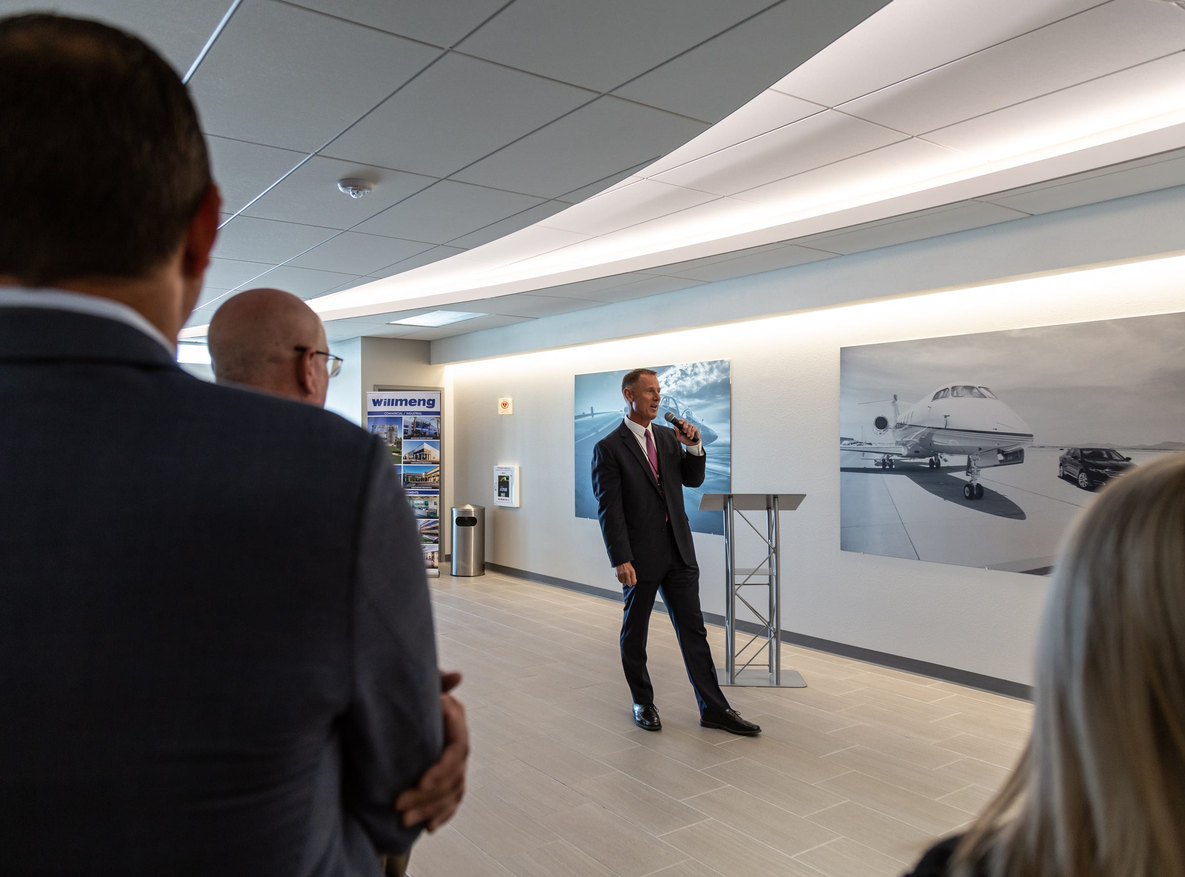 Brian O'Neill, executive director of Phoenix-Mesa Gateway Airport, speaks during the ribbon cutting for the remodeled Gateway Aviation Center.