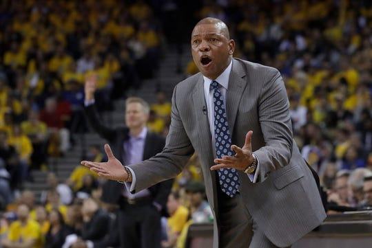 Los Angeles Clippers head coach Doc Rivers gestures toward an official during the first half of Game 2 of a first-round NBA basketball playoff series against the Golden State Warriors in Oakland, Calif., Monday, April 15, 2019.