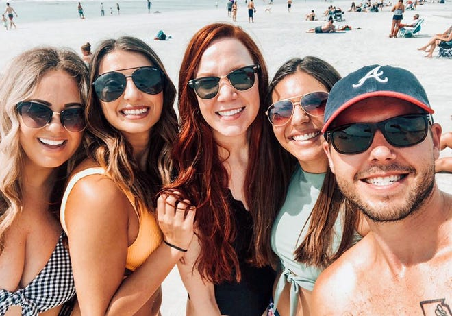 A.T. Still University physician assistant students Mikayla Freeman, Anna Bogdanov, Heather Hargrave, Alyssa Martinez and Will Koopal pose for a photo at Hilton Head Island. Five minutes after this photo, the students witnessed a woman having a seizure and saved her life.