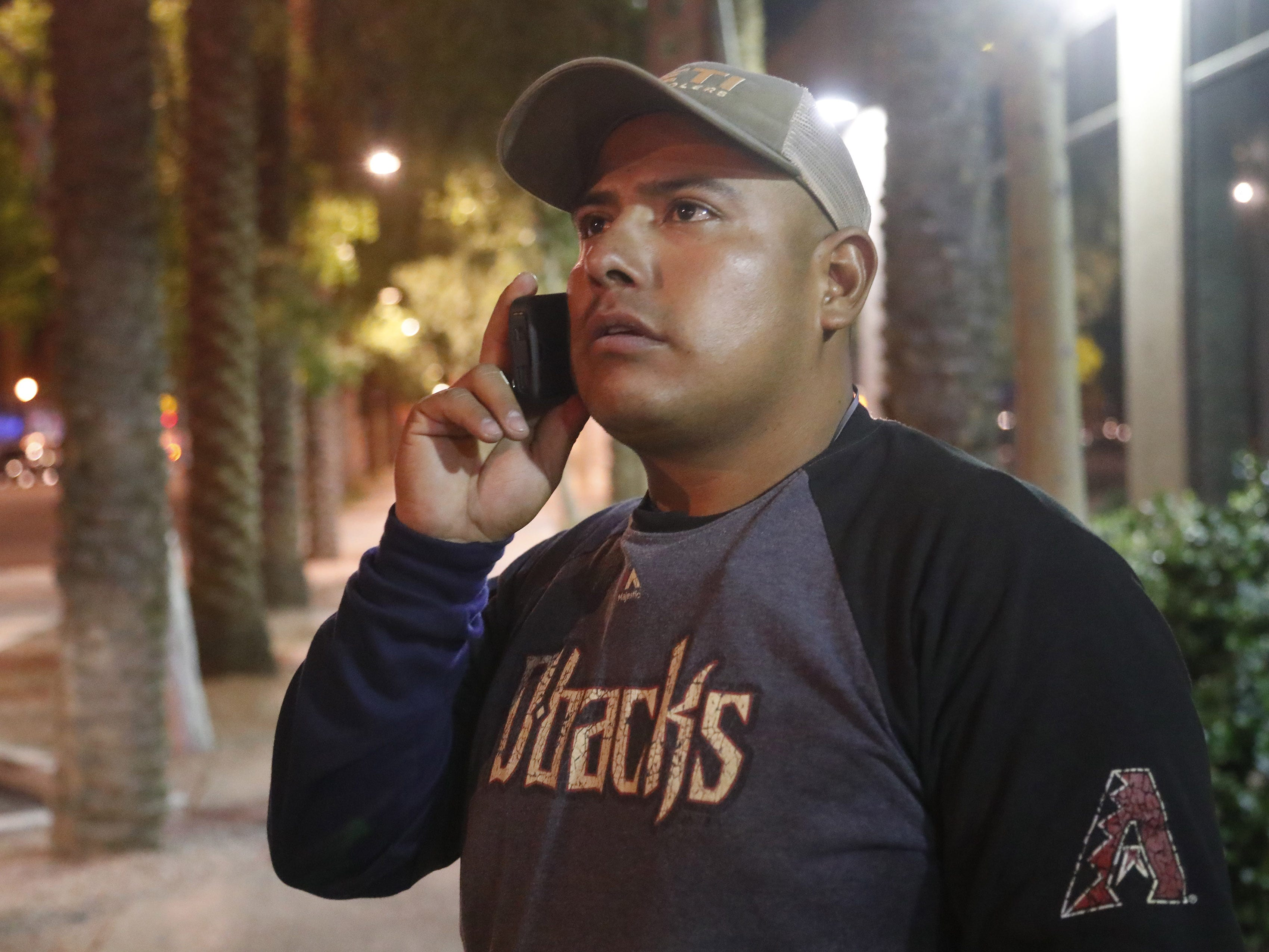 Jose Arturo Gonzalez Carranza, 30, talks on the phone in downtown Phoenix shortly after being released from custody on April 15, 2019.