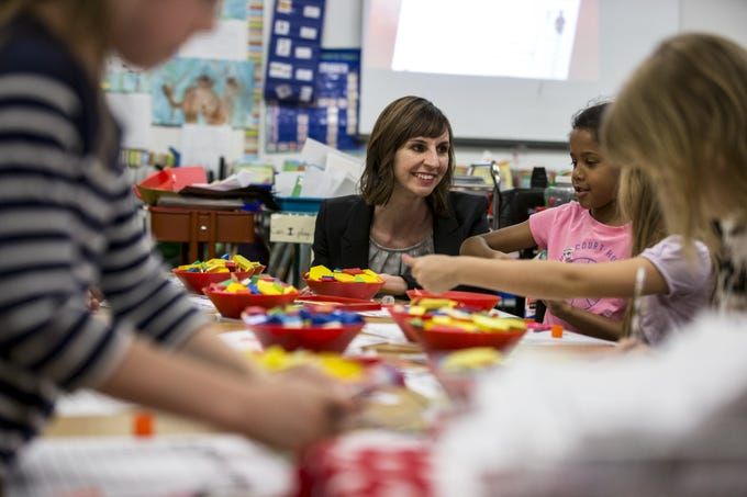 Arizona Superintendent of Public Instruction Kathy Hoffman talks with Reese Williams during class on April 4, 2019, at Mercury Mine Elementary School in Phoenix.