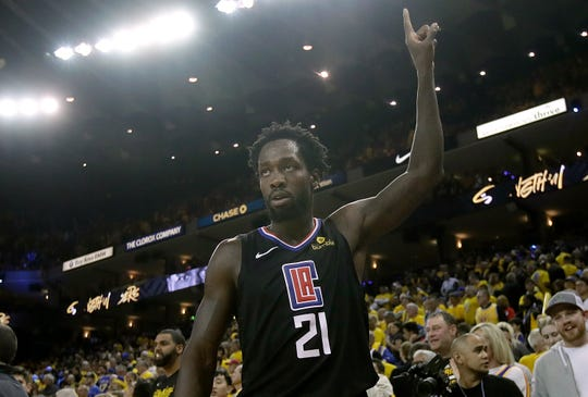 Los Angeles Clippers guard Patrick Beverley celebrates during the second half of Game 2 of a first-round NBA basketball playoff series against the Golden State Warriors in Oakland, Calif., Monday, April 15, 2019.
