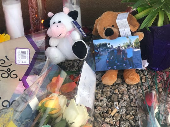 Photos, notes and stuff animals were among the items place at the scene where Alexander Pettygrove, 18, crashed his vehicle after being fatally shot in an apparent road rage incident in Glendale.