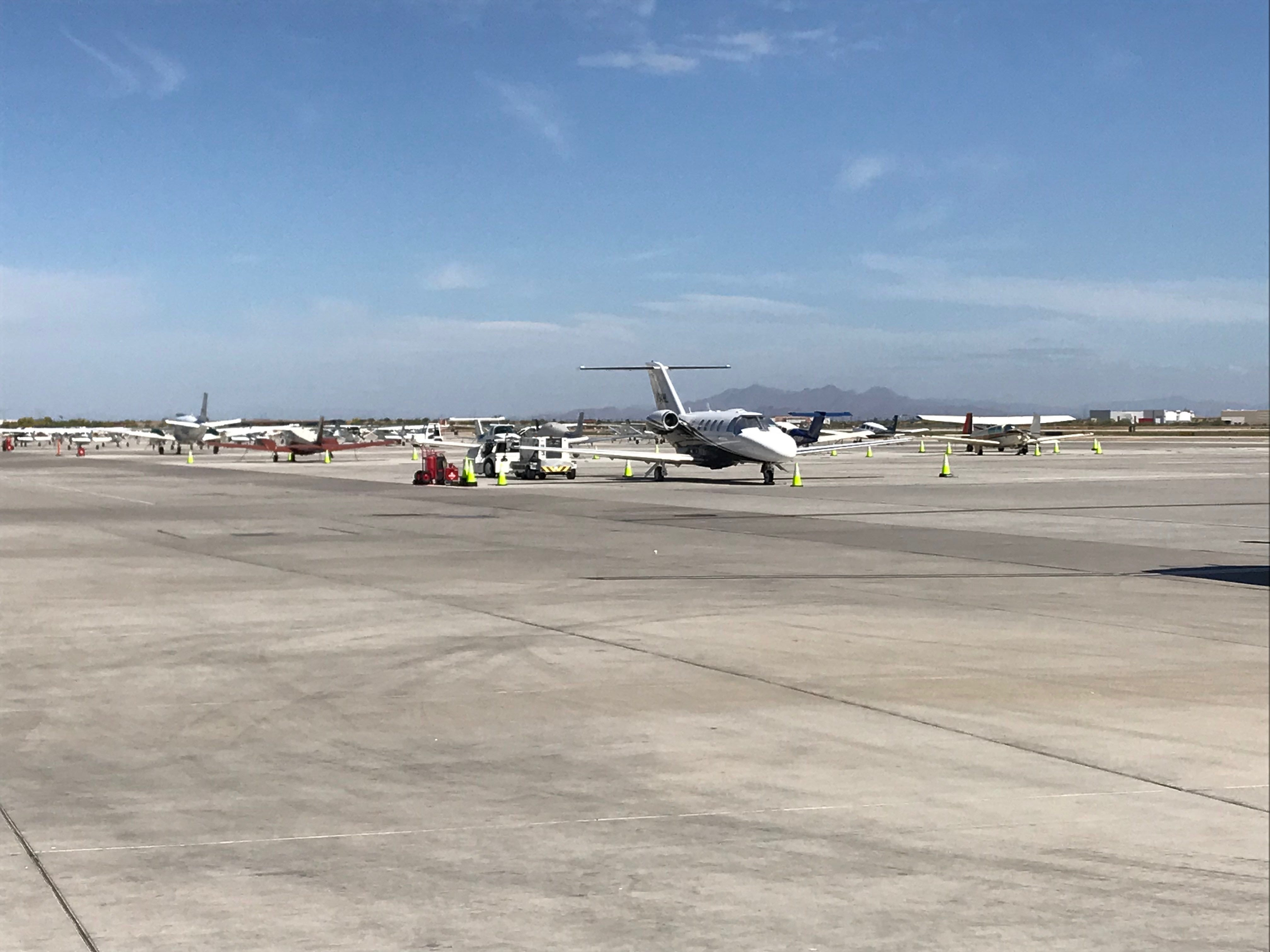 Private planes parked outside Gateway Aviation Services at Phoenix-Mesa Gateway Airport.