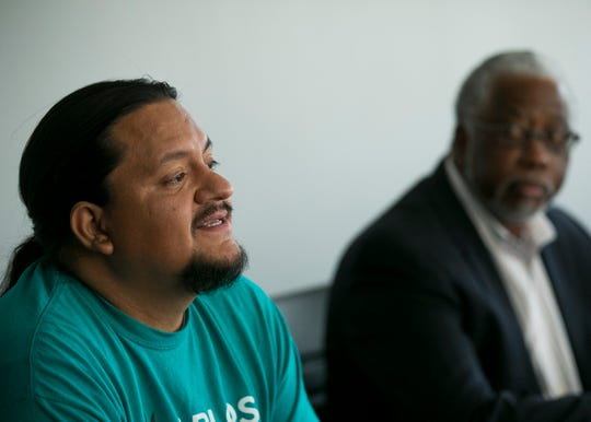 District 8 candidates Carlos Garcia (left)  and  Mike Johnson (right) speak with the editorial board of the Arizona Republic in Phoenix, Ariz. on Tue. April 16, 2019. The two candidates will face off in a May 21 runoff election.