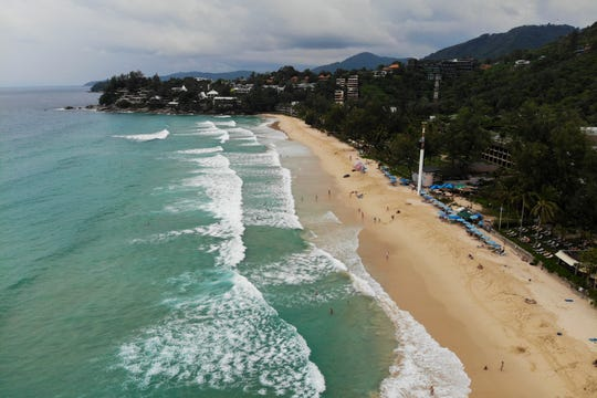 This aerial picture taken on October 11, 2018, shows tourists enjoying at the Kata Noi Beach in Phuket.
