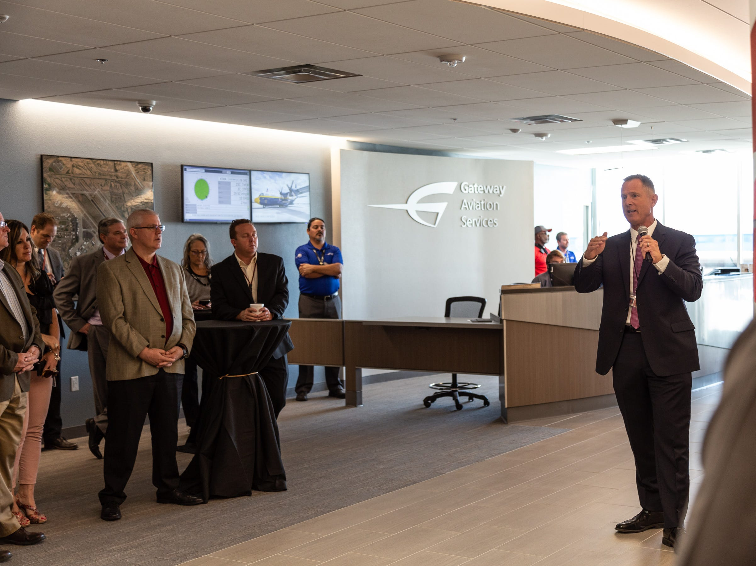 Brian O'Neill speaks to a crowd inside the renovated Gateway Aviation Center. It offers fueling and other services for private and corporate jets at Phoenix-Mesa Gateway Airport. It also hosts military pilots and aircraft.