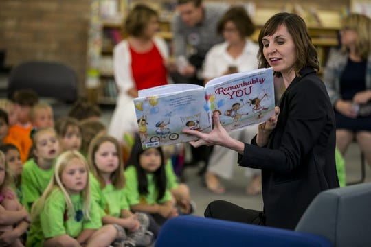 Arizona Superintendent of Public Instruction Kathy Hoffman reads a book to students at Mercury Mine Elementary School in Phoenix on April 4, 2019.