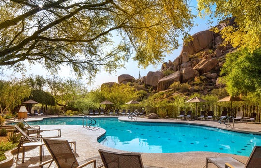 Go for a refreshing swim or relax poolside with a cool drink at The Boulders Resort.