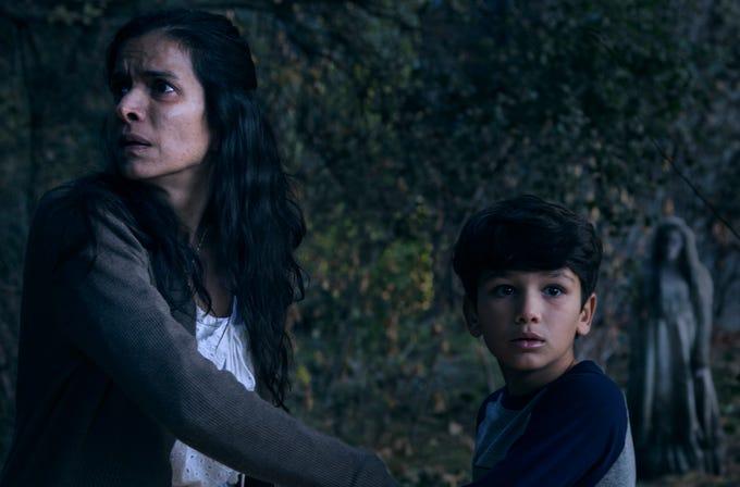 "Look behind you! Patricia (Patricia Velasquez) and Chris (Roman Christou) don't know that La Llorona (Marisol Ramirez) is near in ""The Curse of La Llorona."""