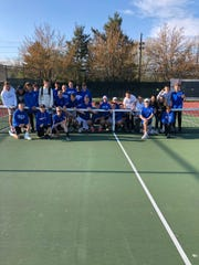 The Cedar Crest boys tennis team celebrates its first Section 1 title since 1994.