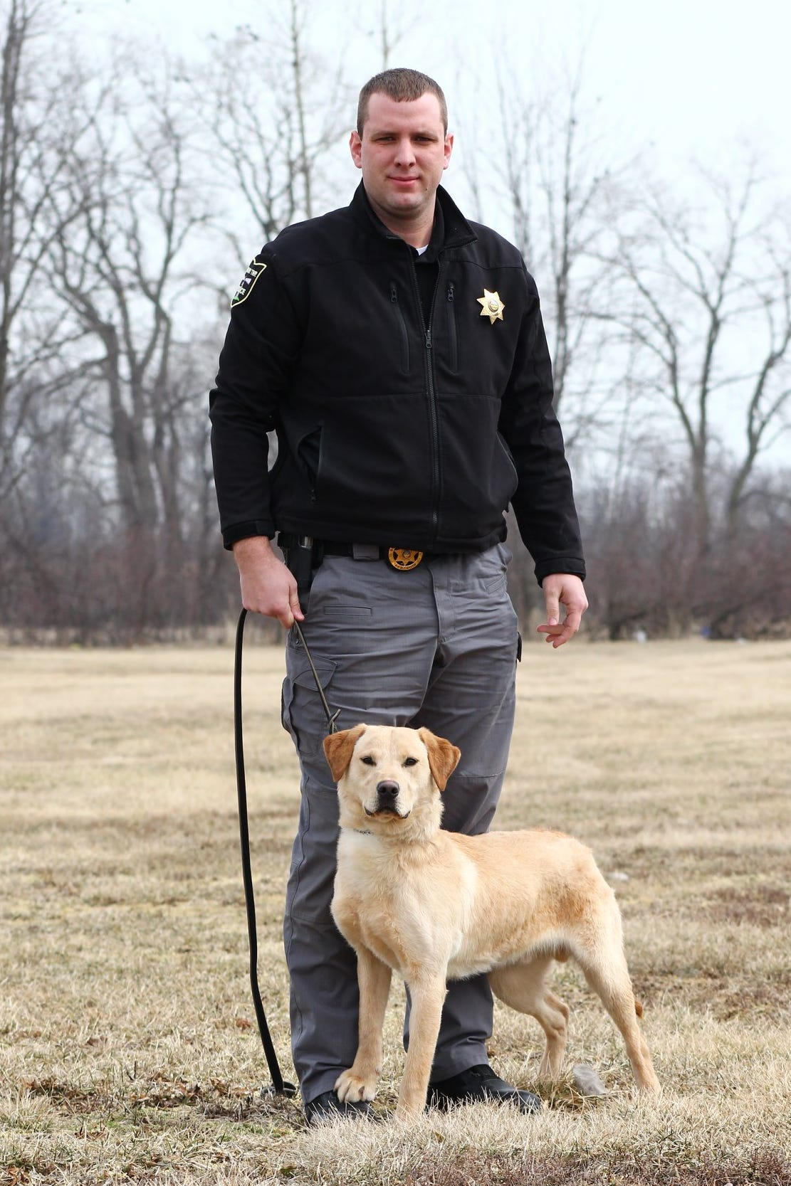 Danbury Township Police Officer Brian Sloan and his new K-9 partner Kalahan, a 1-year-old Labrador Retriever, are working together to keep drugs out of the community.